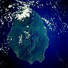 Oval_shaped Réunion Island, one of the Mascarene Islands, is shown in this low_oblique, southeast_looking photograph. The island is 39 miles 63 kilome...