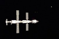 Backdropped against the blackness of space, the International Space Station ISS is seen following its undocking with the Space Shuttle Atlantis. After...