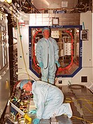 02/03/2000 ___ STS_98 Commander Kenneth D. Cockrell left and Mission Specialist Thomas D. Jones Ph.D. check out equipment in the U.S. Lab Destiny duri...