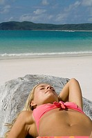 Woman sunbathing.  Whitehaven Beach, Australia