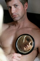 A man focuses a mirror on a womans face