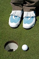 View of a person standing near a golf hole