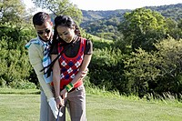 View of a man teaching golf game to a woman