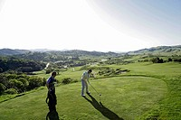View of young men playing golf