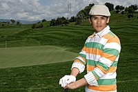 Portrait of a young man posing during a golf game
