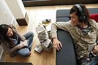 Two people sitting inside room, high angle view