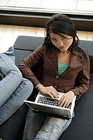 Young woman using on laptop, high angle view