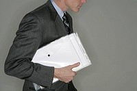 Businessman with documents, profile
