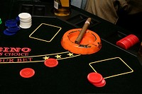 View of poker chips and cigar on a green board