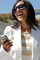 Portrait of a young woman holding a cellphone