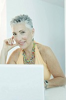 View of a mature woman with a laptop