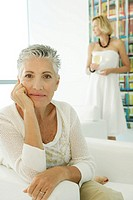 Two women inside a living room (thumbnail)