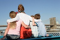 Back view of a family sitting on a ferry