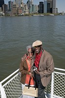 Mature couple standing on a boat