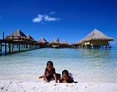 Marine house Boy Sea Transparent Blue sky Clouds Beach Child The Bora Bora island and Tahiti