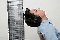 View of a boy near a piled of compact discs