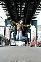 View of a young woman jumping (thumbnail)