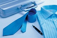 A briefcase,fountain pen,blue shirt and a necktie