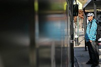 Teenage boy 15-17 standing at bus stop (thumbnail)