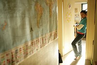 Teenage girl 15-17 leaning on doorframe (thumbnail)