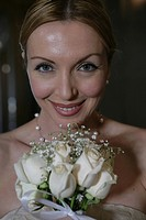 Mature women holding a bouquet of white roses (thumbnail)