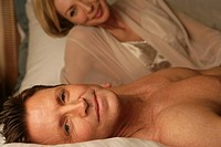 Mature couple in bed together