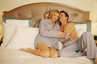 Mature couple in bed in pajamas (thumbnail)