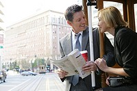Couple riding a trolley car