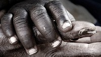 Baby and grandmother's hands. Gambia