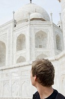 Close-up of a young man looking at a mausoleum, Taj Mahal, Agra, Uttar Pradesh, India