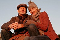 Mature couple wearing hat and scarves
