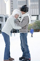Mature couple holding each other on an ice skating rink