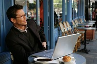Mature busines man at a cafe