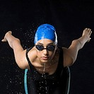Close-up of a young woman standing in a position to dive