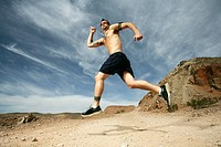 Caucasian man in shorts running