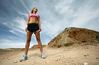 Woman in athletic wear standing in the desert