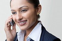 Close-up of a businesswoman talking on a mobile phone and smiling
