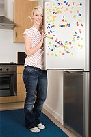 Woman opening a fridge