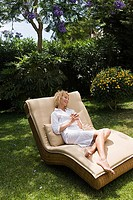 A woman relaxing on a sun lounger