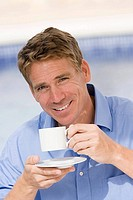Portrait of a mature man holding a cup