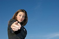 A businesswoman pointing