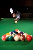 one man playing billiards