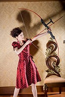 one fashionable woman practicing archery
