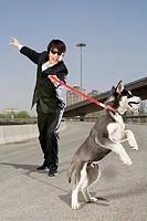 Man holding dog on an overpass