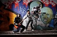 Young men playing guitar while woman singing