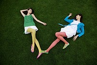 Young women posing on lawn