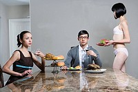Woman serving men and women at breakfast table