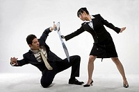 a business woman and a man practicing Chinese Kungfu with swords