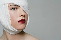 Woman with her head bandaged