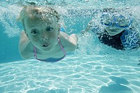 Boy and girl swimming